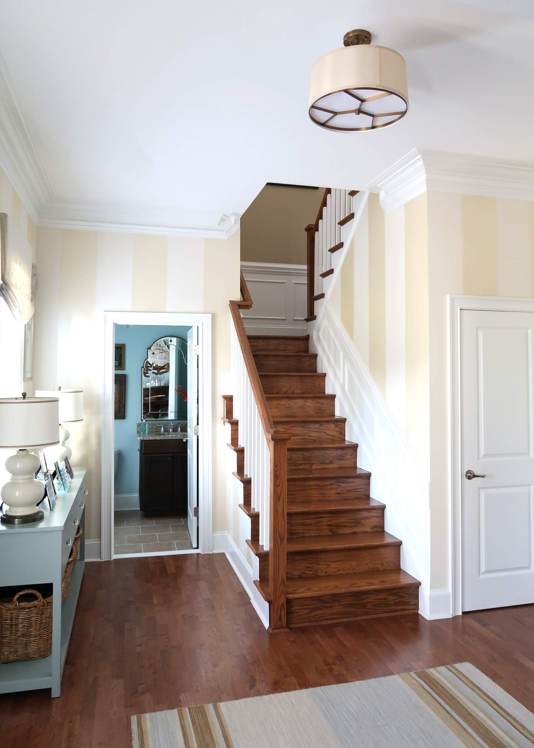Foyer Staircase with Striped Walls