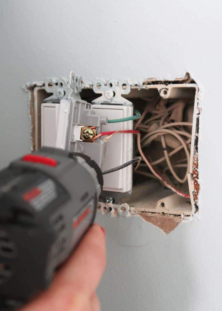 Remove screws from existing light fixture before installing dimmer switch