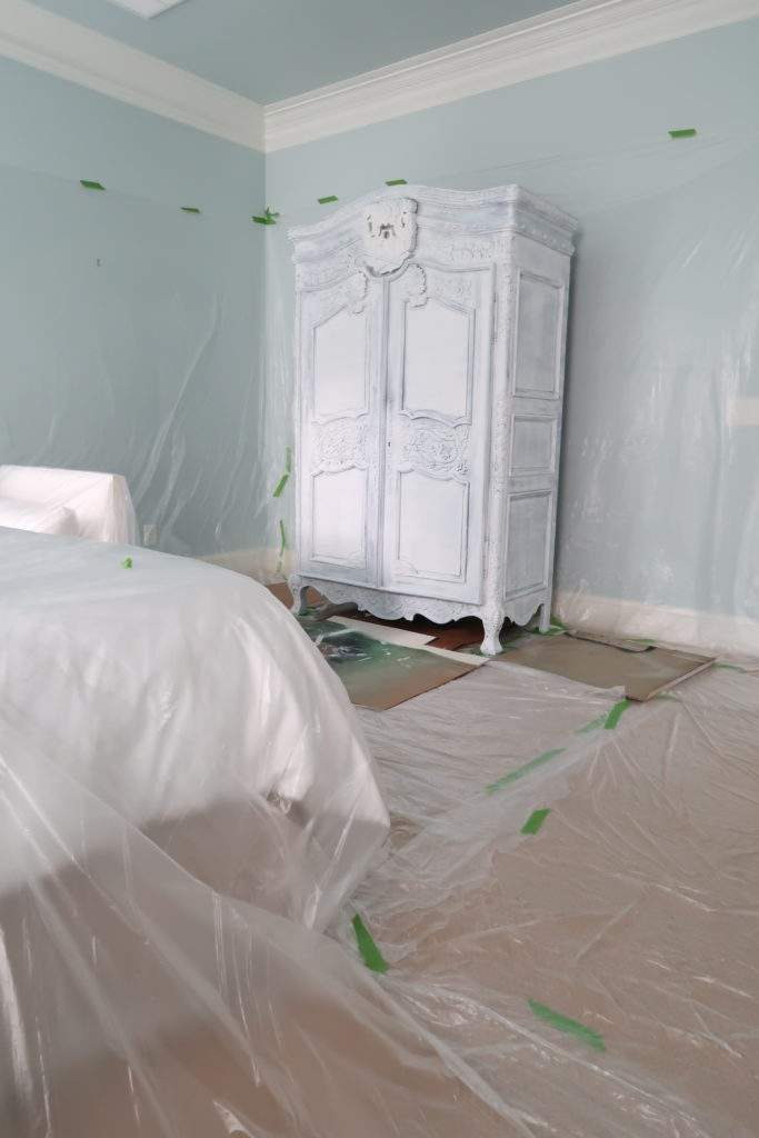 Walls and floors covered in plastic prior to spray painting