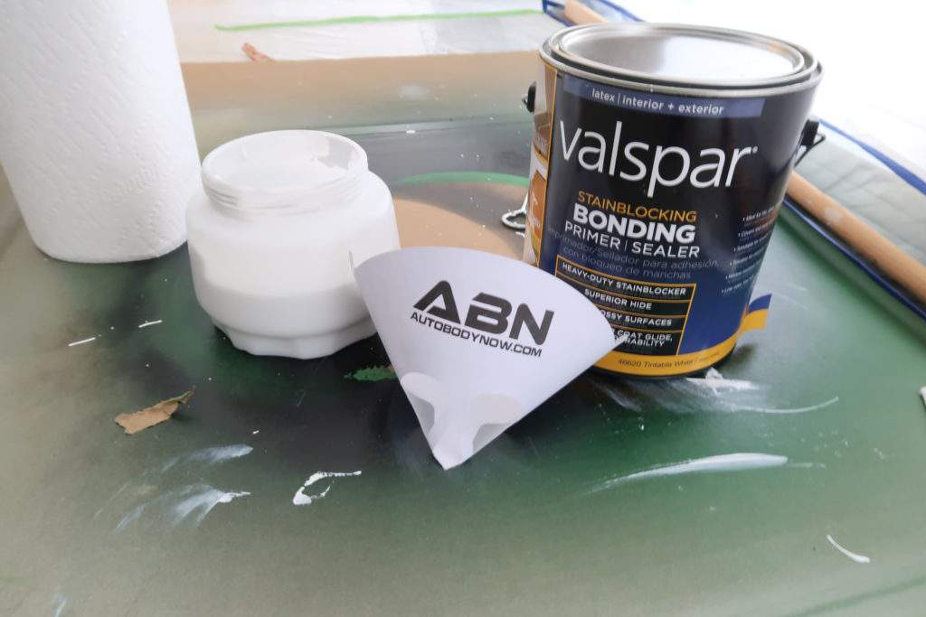 Valspar Bonding Primer with paper paint strainer, paper towels and paint sprayer container