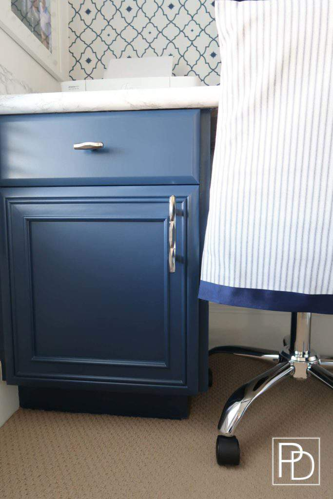 Slip Covered Chair-Amerock Hardware-Marble Counter-Navy Cabinets
