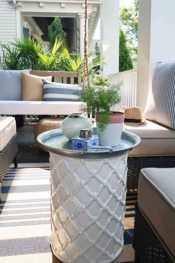 Use a garden stool as a small table by adding a galvanized tray