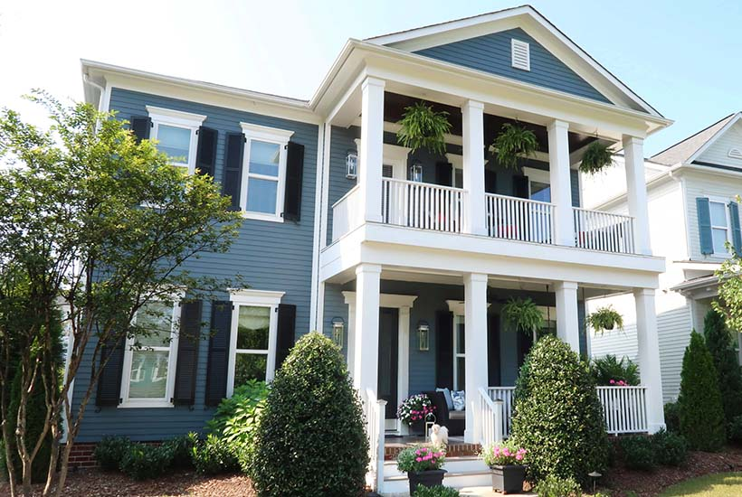 blue house with double front porches charleston style house with southern charm