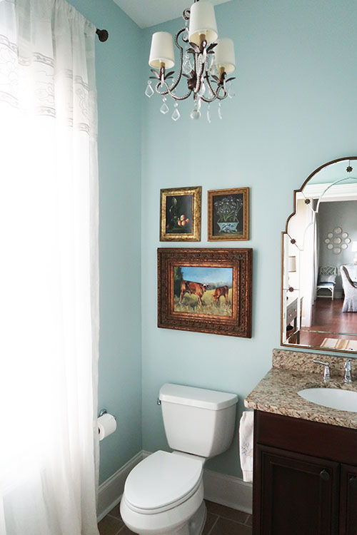 view of the powder room with toilet and drapes