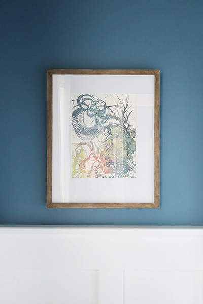 Kristina Hoover Fine Art hanging on blueprint wall