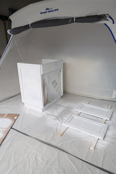 home right paint spray tent and primed cabinet