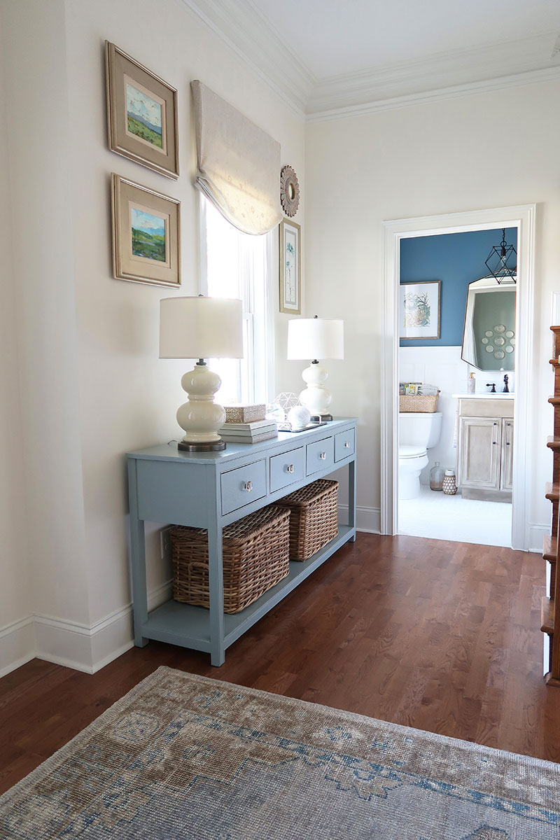 Looking-from-foyer-into-modern-coastal-powder-room-pottery-barn-finn-rug