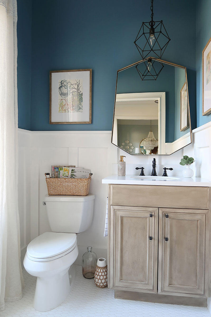 Modern-Coastal-Powder-Room-with-Blueprint-Color-of-the-Year-and-Seadrift-Vanity-with-Black-Hardware