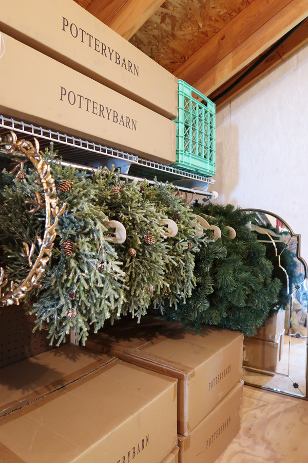 Store-wreaths-on-hangers-in-the-attic