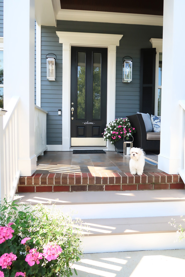 black-front-door-entry-way-coastal-blue-home-with-new-exterior-lights