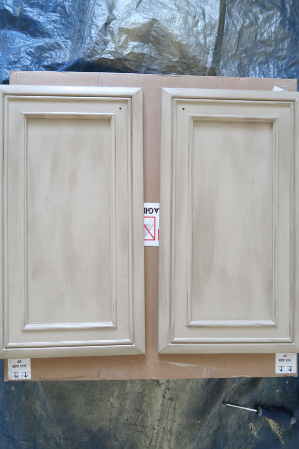 first-coat-of-glaze-applied-to-doors