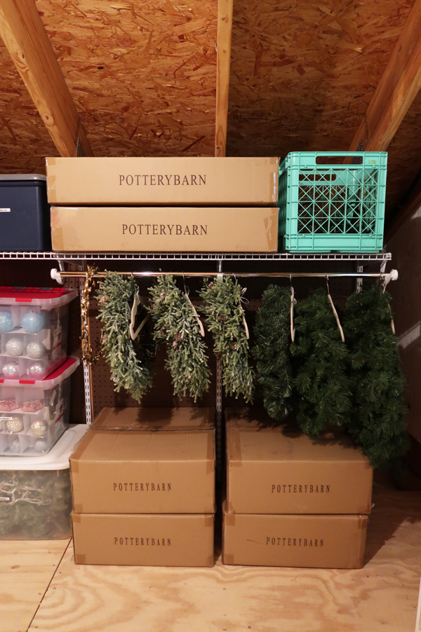 wreath-organization-station-in-attic-hanging-wreaths-on-rod