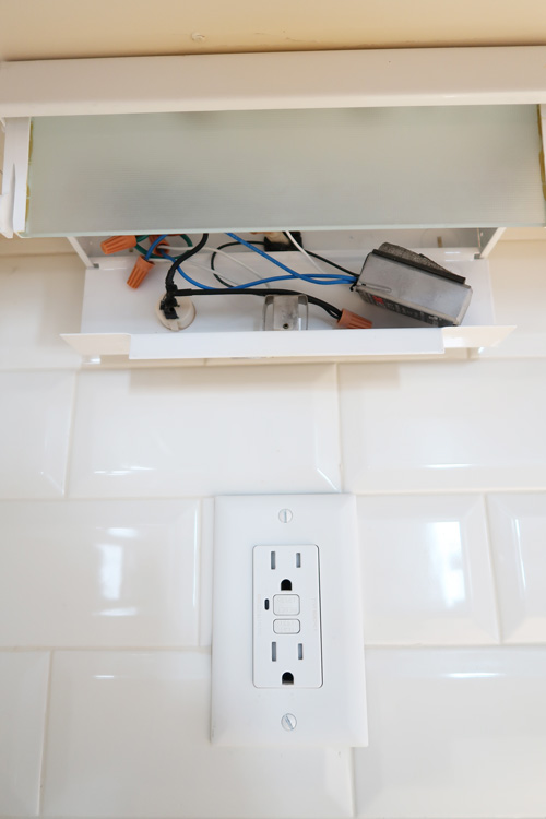 drop-down-panel-to-expose-wiring-of-under-cabinet-lighting