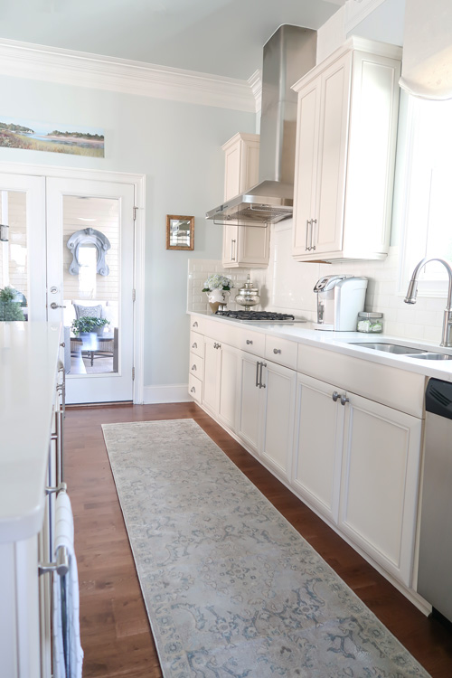 gray-blue-kitchen-runner-between-island-and-cabinets