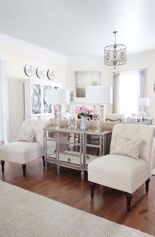 family-room-sitting-area-cream-slipper-chairs-deep-crown-moulding