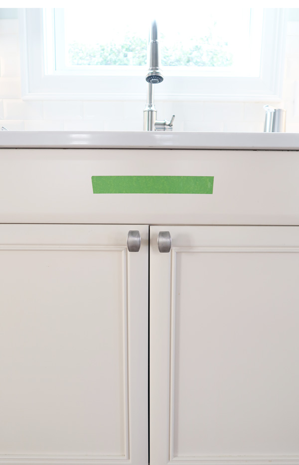 place-painters-tape-on-cabinet-decide-pull-length