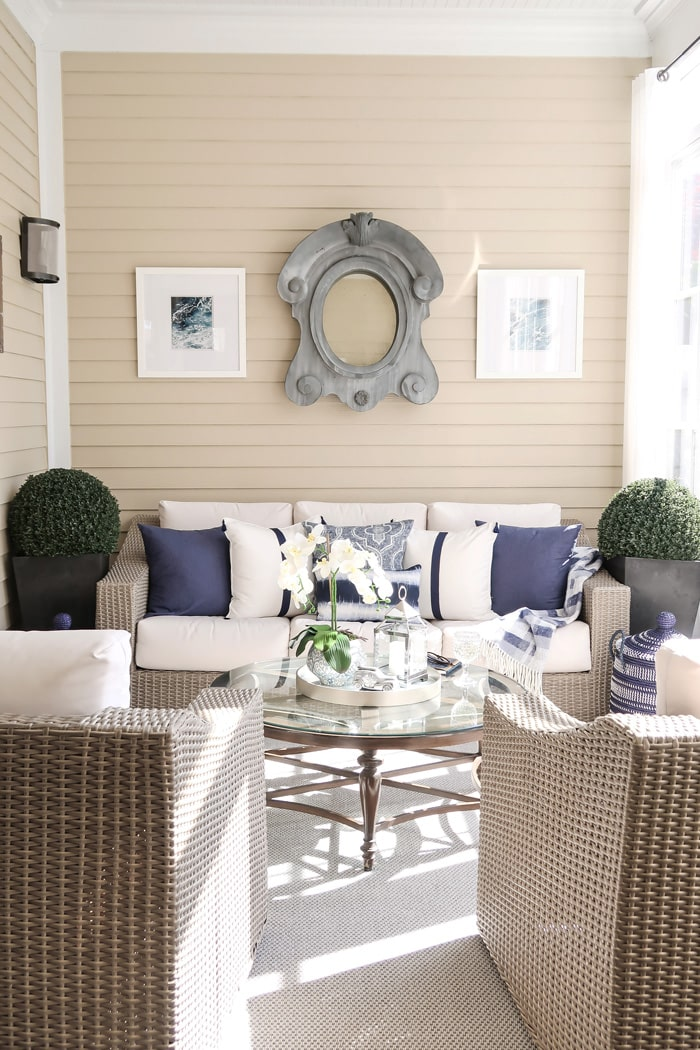 screened-porch-chairs-sofa-driftwood-white-navy-pillows-min