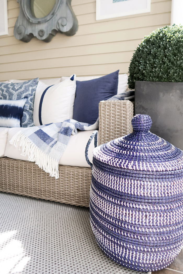 serena-and-lily-navy-la-jolla-basket-mohawk-home-rug-white-navy-sofa-throw-min