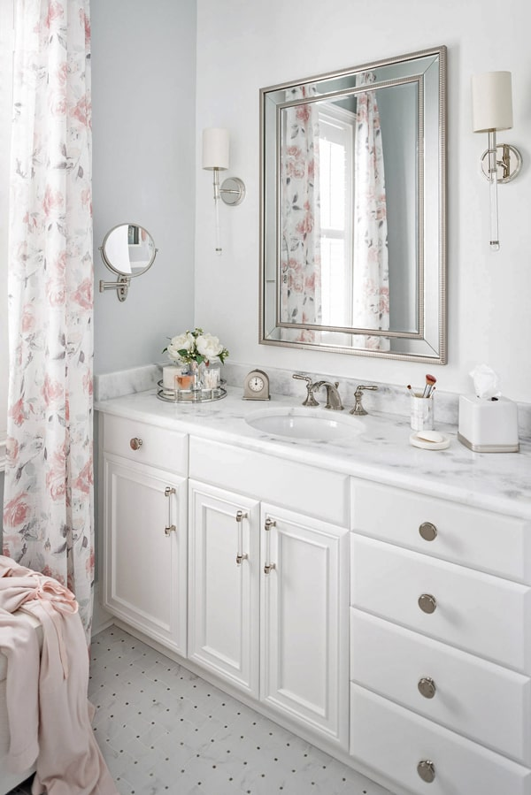 painted-benjamin-moore-decorator's-white-cabinets-polished-nickel-hardware-master-bathroom-remodel-scones-on-either-side-of-mirror-shadow-storm-marble-porch-daydreame