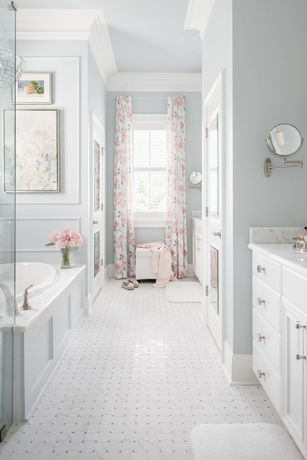 remodel-master-bathroom-benjamin-moore-wales-gray-mosaic-tile-floor-shadow-storm-marble-counters-white-vanities-floral-drapes-min