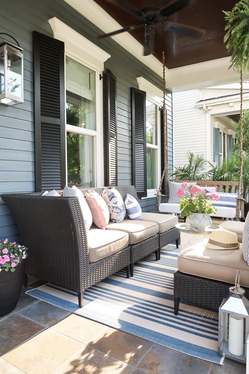ceiling-fan-dark-ceiling-small-front-porch-blue-and-white-striped-rug-and-pillows_3