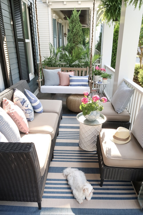 small-front-porch-with-lots-of-seating-blue-and-white-decor-with-pops-of-pink_3