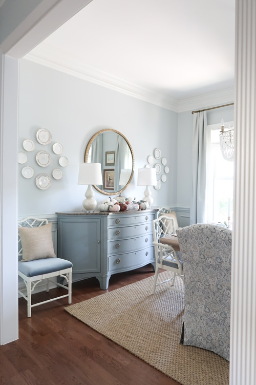 looking-through-doorway-to-dining-room-table-and-credenza-in-blue