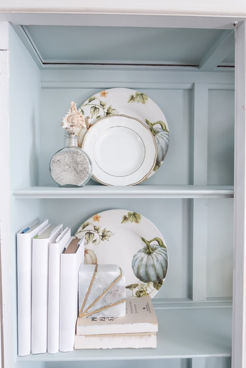pumpkin-and-white-plates-with-books-for-fall