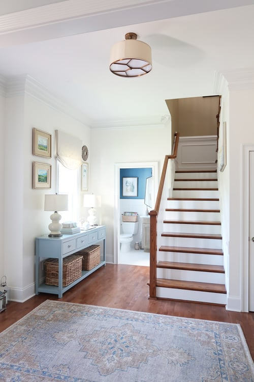 vintage rug-view-from-the-dining-room-looking-at-newly-painted-staircase