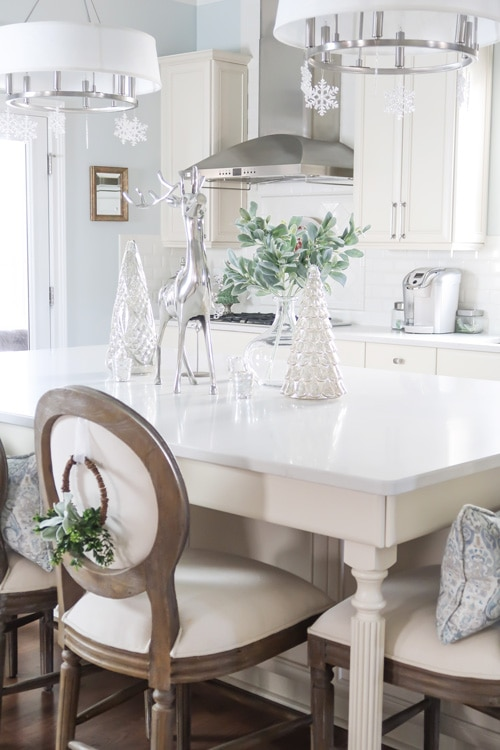 Kitchen-island-snowflakes-hanging-from-fixtures