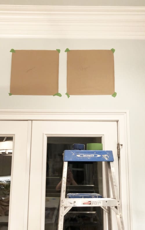 Step-two-hang-cut-outs-of-artwork-on-wall-in-a-row-for-placement-with-painters-tape
