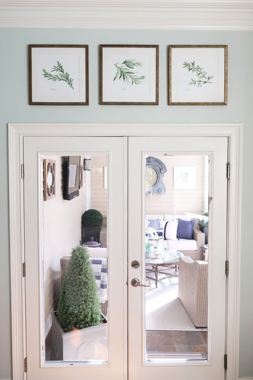 how-to-hang-artwork-evenly-in-a-row-how-to-hang-three-pictures
