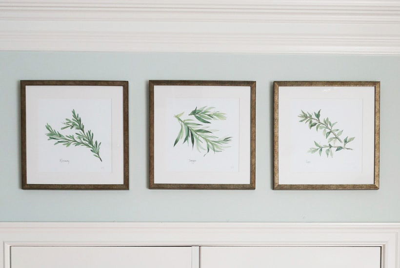 set-of-three-herb-print-artwork-hanging-evenly-in-a-row