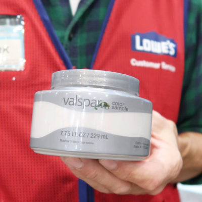 Lowes-paint-employee-holding-custom-tinted-valspar-paint-sample