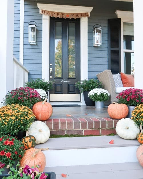 angled-fall-front-entry-gold-mums-white-orange-pumpkins-happy-fall-sign